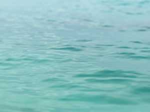 Close shot of small wavelets in Bimini, The Bahamas.